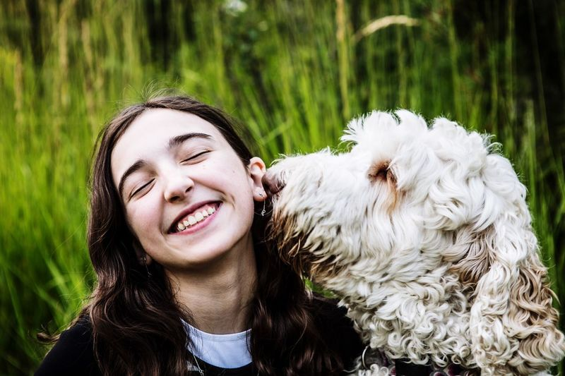 Smiling Teenage Girl With Dog