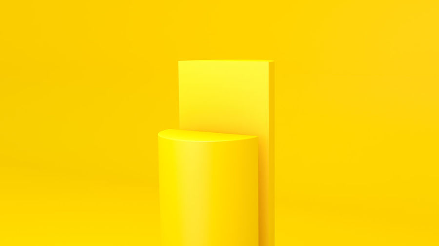 Close-up of illuminated lamp against yellow wall