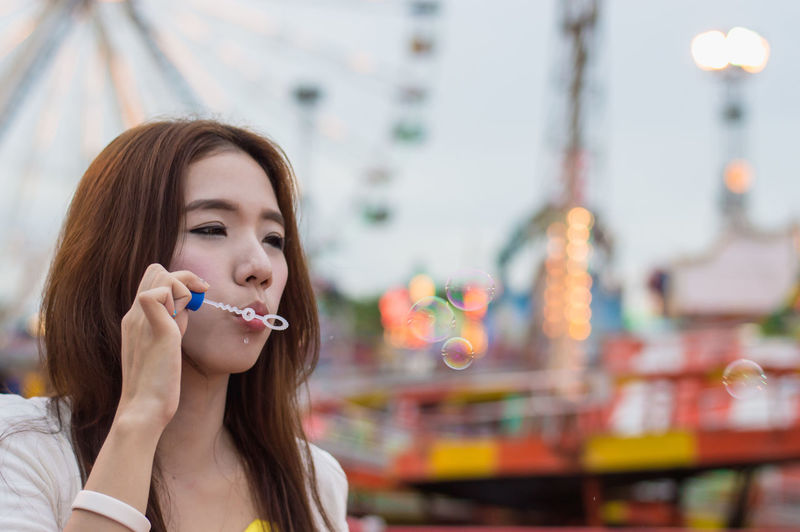 Beautiful women are happy in the amusement park. Adult American Amusement  Asian  Background Banner Beautiful Blur Bubble Carousel Cheerful Coney Cute Embracing Enjoy Enjoyment Entertainment Female Ferris Fun Girlfriend Happiness Happy Hold Holiday Hugging Image Island Japan Joy Korea Laughing Leisure Lifestyle Lollipop Outdoors People Photo Play Portrait Pretty Recess Relax Selfie Smiling Sunset Teens Together Woman Young