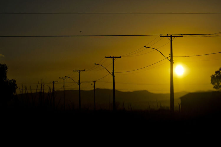 Tarde Beauty In Nature Cable Cabos Connection Electricity  Electricity Pylon Energía Fios Landscape Nature Orange Color Outdoors Por Do Sol Postes Power Line  Power Supply Silhouette Sky Sun Sunset Tarde  Telephone Line Telephone Pole Tranquil Scene Tranquility