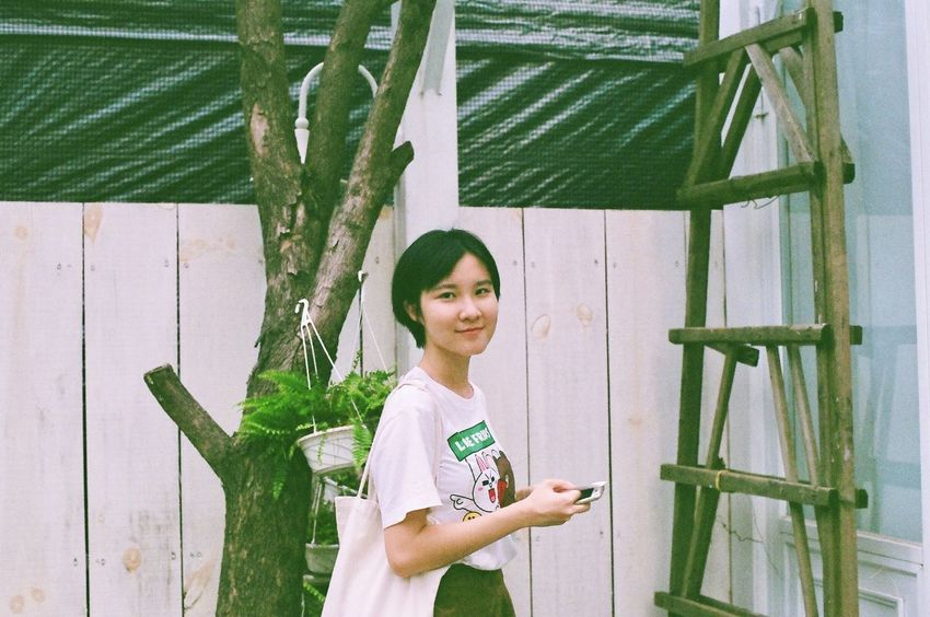 Be. Ready. Canon Looking At Camera Portrait One Person Lifestyles Smiling Green Color Day Confidence  Young Adult Real People Standing Leaf Young Women Adult Bamboo - Plant Only Women One Woman Only Adults Only Indoors  Tree Ae-1 My best friend