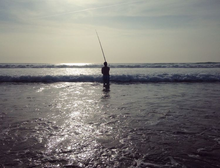 Sea Fishing Horizon Over Water Fishing Pole Fishing Rod Water One Person Tranquil Scene Nature Beauty In Nature Weekend Activities Tranquility Scenics Silhouette Standing Idyllic Leisure Activity Outdoors Men