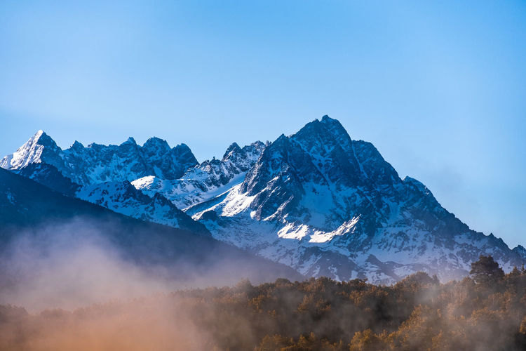 Mountain Scenics - Nature Sky Beauty In Nature Cold Temperature Winter Tranquil Scene Mountain Range Tranquility Snow Non-urban Scene Snowcapped Mountain Nature No People Environment Copy Space Blue Clear Sky Day Mountain Peak Formation Meili DeQin Yunnan China Tibet Top High Fog Cool Cold