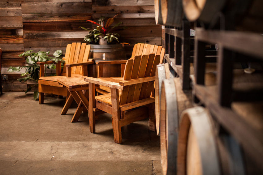 Absence Brown Business Cafe Chair Flower Flowering Plant Food And Drink Furniture Indoors  Nature No People Plant Refreshment Restaurant Seat Selective Focus Table Wood - Material