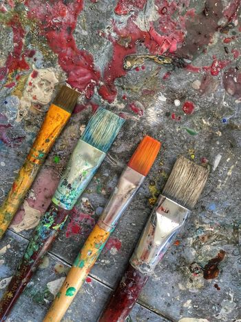 Colorful oil paint brushes Art And Craft Paintbrush High Angle View Oil Paint Work Tool Indoors  Variation Palette No People Multi Colored Paint Roller Close-up Day Art Studio Art Painting Brushes