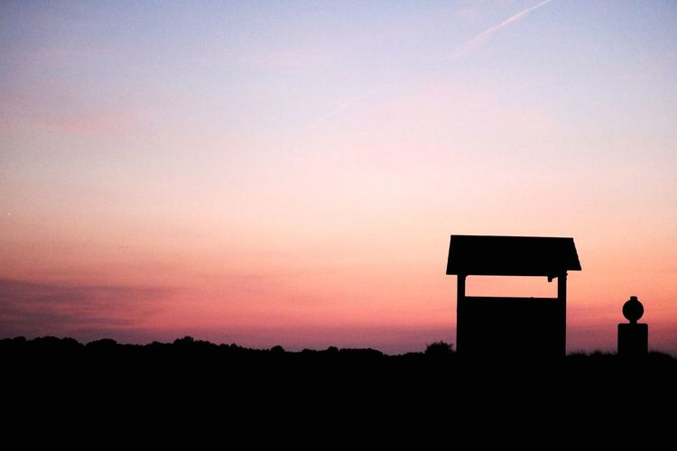 Silhouette Sunset Sky Copy Space Orange Color Dusk Nature Architecture No People Built Structure Outdoors Beauty In Nature Scenics - Nature Tranquil Scene Plant Tranquility