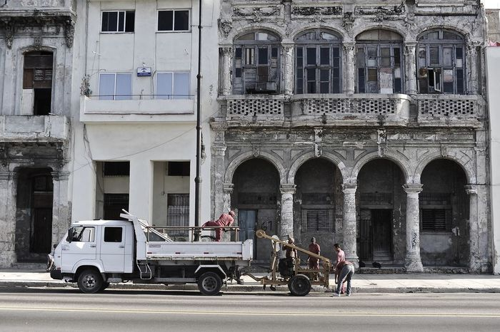 Animal Themes Architecture Balcony Building Exterior Built Structure City Day Havana, Cuba Jobs One Person Outdoors People Streetphotography Transportation