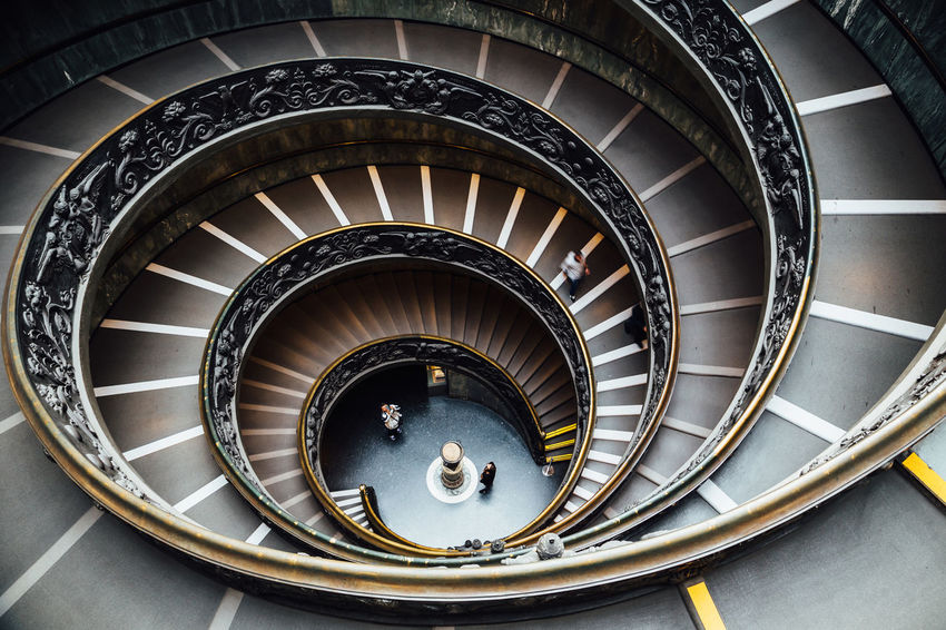The 'Bramante' spiral stairs of the Vatican Museums Rome Travel Architecture Building Built Structure Design High Angle View Leisure Activity Lifestyles Lines And Shapes Ornate Pattern Railing Real People Spiral Spiral Staircase Staircase Steps And Staircases Travel Destinations Vatican Museum