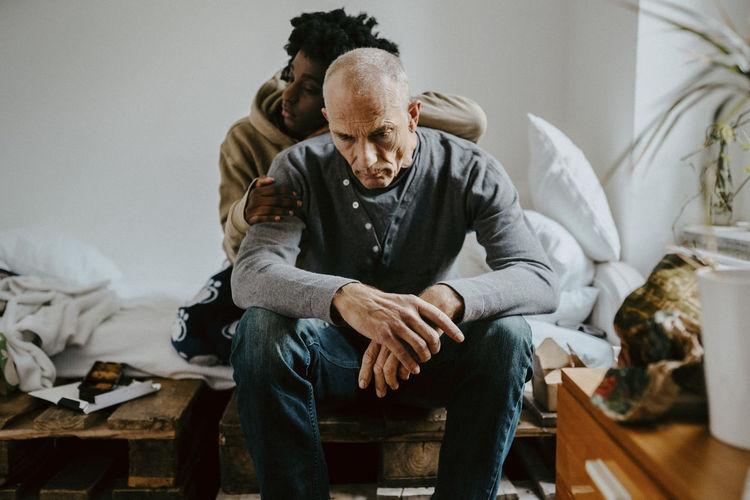 Men sitting at home