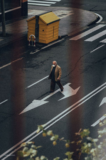 High angle view of man walking on road