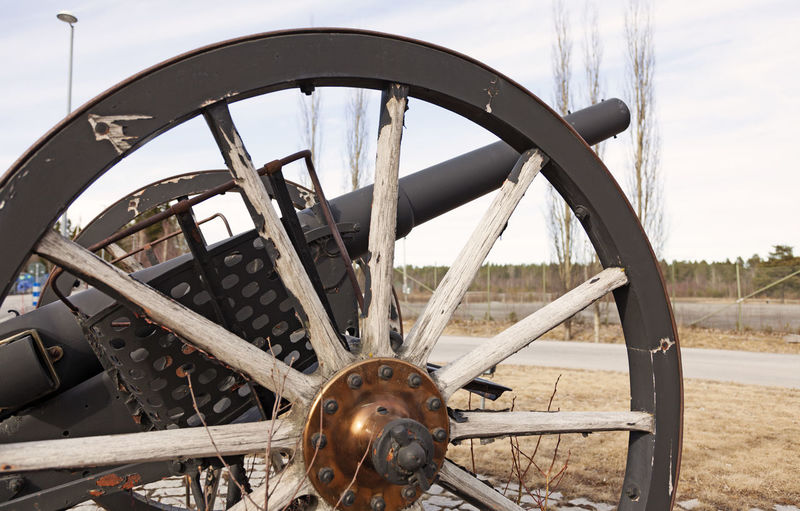An old military cannon standing by the road as an exhibition