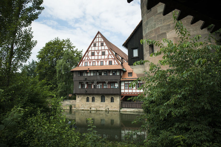 Nürnberg Architecture Building Building Exterior Built Structure Canal Cloud - Sky Day Green Color Growth House Nature No People Outdoors Plant Reflection Residential District Sky Tree Water Window