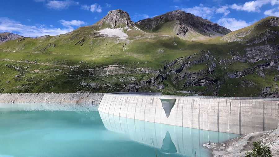 Architecture Beauty In Nature Built Structure Dam Day Environment Flood Fuel And Power Generation Hydroelectric Power Lake Man Made Mountain Mountain Peak Mountain Range Nature No People Outdoors Scenics Sky Travel Destinations Water