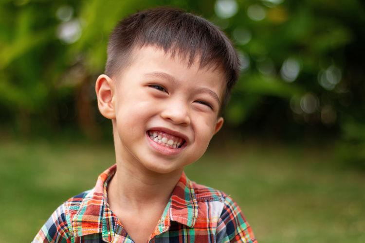 Close-up portrait of smiling cute boy