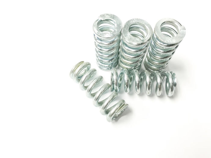coil spring, metal dark spring isolated on white background Presenting conceptual objects in the industry. Coil Spring Close-up High Angle View Large Group Of Objects Metal Metal Dark Spring No People Nut - Fastener Silver Colored Still Life Studio Shot White Background