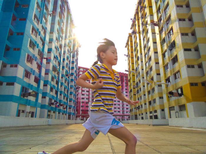 Full length of girl in city