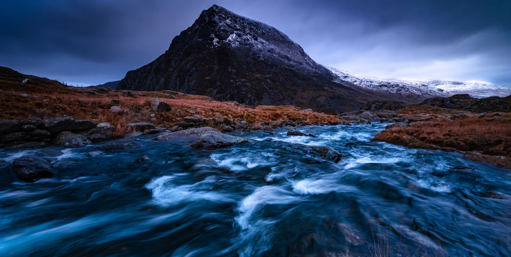motion and stillness Mountain Snow Water Winter Cold Temperature Lake Mountain Peak Dramatic Sky Flowing Water Stream - Flowing Water Long Exposure Flowing Rock Formation