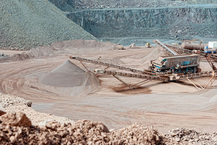 stone crusher in a quarry. mining industry Stone Pit Transportation Production Construction Materials Construction Material Steinbruch Rocks Stonepit Quarry Rock Quarry Mining Minerals Steinbrecher Mine Stone Crusher Conveyor Belt Loading