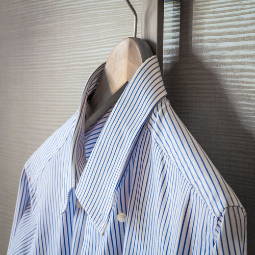 Close-up of striped shirt hanging on coathanger