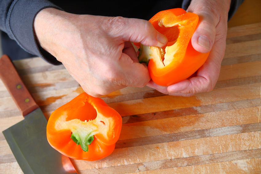 Bell Pepper Close-up Cutting Board Cutting Boards Day Fingers Fresh Produce Freshness Healthy Eating Healthy Lifestyle Holding Indoors  Kitchen Knife Kitchen Skills Natural Light One Man Only One Person Orange Color Overhead Preparing Food Raw Food Seeding Senior Man Text Space Vegetable