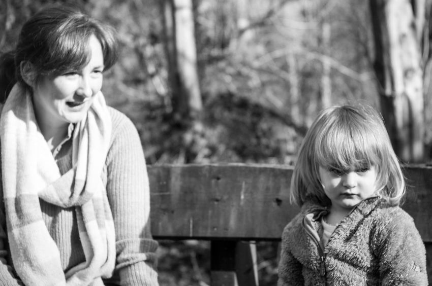Mother and Child Sitting on Bench Adult B&w Black And White Blackandwhite Blond Hair Child Childhood Day Discussion Forest Friendship Looking Down Nature Observing Observing The World Outdoors Parent Parenthood People Sitting Smiling Springtime Two People Woods EyeEm Premium Collection