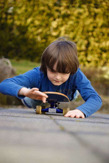 Portrait of boy playing with mobile phone