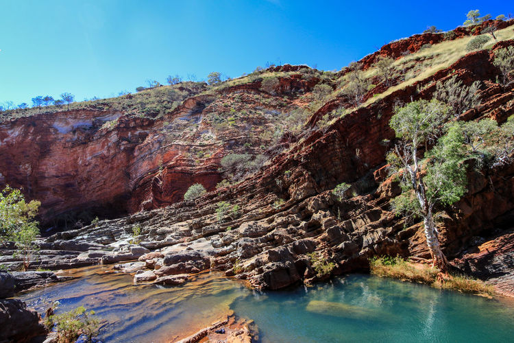 Hammersley Gorge, Karijini National Park, Western Australia EyeEm Best Shots EyeEmNewHere The Week On EyeEm Australia & Travel Beauty In Nature Blue Clear Sky Day Geology Karijini National Park Landscape Mountain Nature No People Outdoors Physical Geography Rock - Object Rock Formation Scenics Sky Tranquil Scene Tranquility Travel Destinations Tree Water Lost In The Landscape