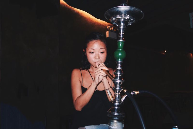 Shisha Smoking Real People One Person Young Adult Holding Night Indoors  Illuminated Portrait Young Woman Bar Hookah Asian Ethnicity