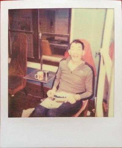 My Husband <3 The Den Reading & Relaxing Real Polaroid