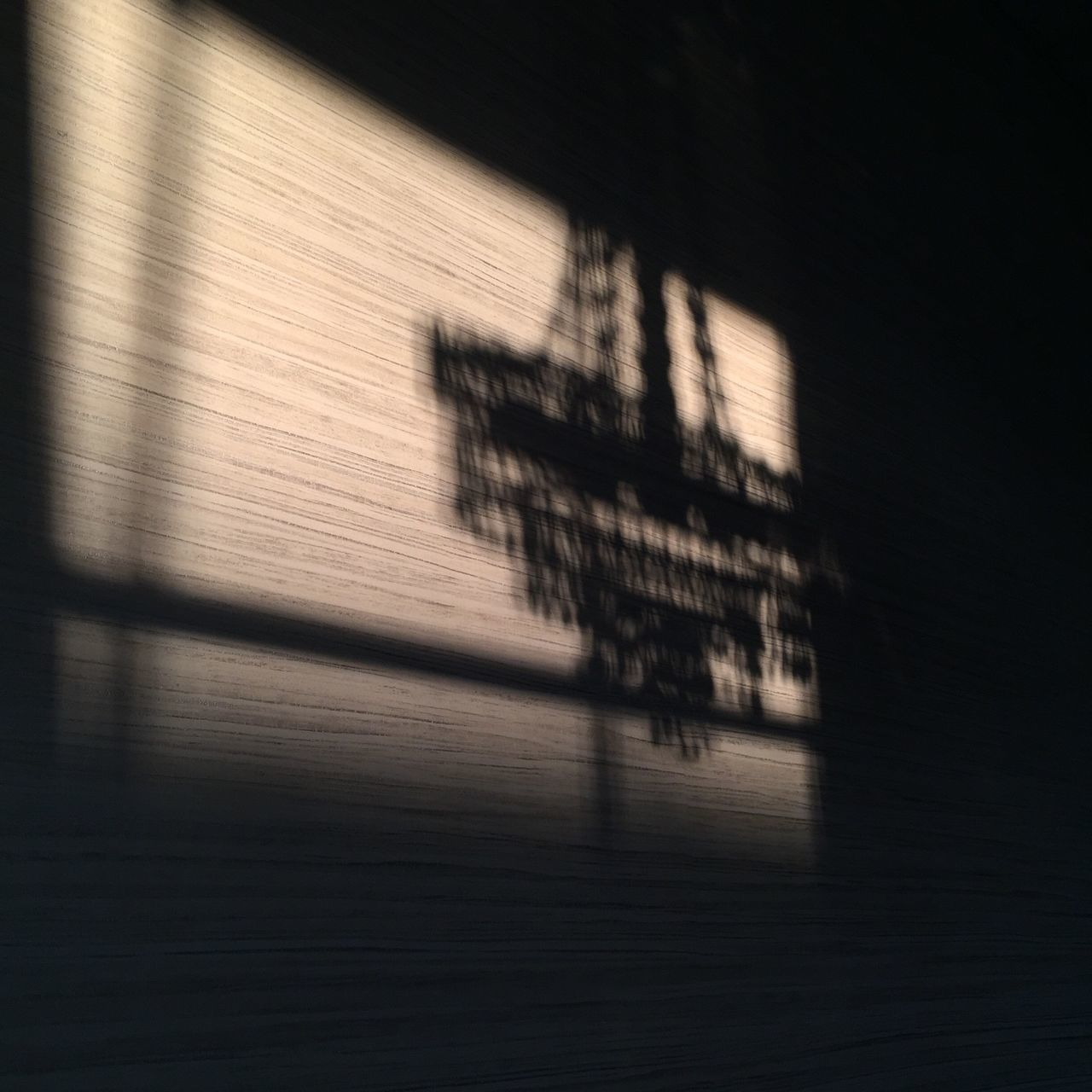 Shadow From Chandelier On Wall