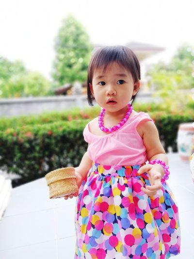 Cute Girl Standing On Floor