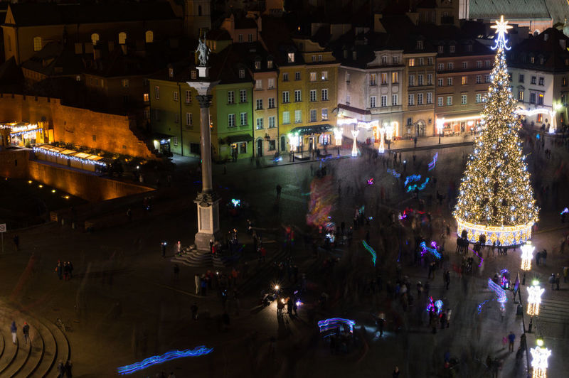 Poland Warsaw Europe Illuminated Night City Architecture Built Structure Building Exterior Street Transportation City Life Incidental People Mode Of Transportation Decoration Outdoors Celebration Holiday Building Motor Vehicle High Angle View Group Of People Nature Light