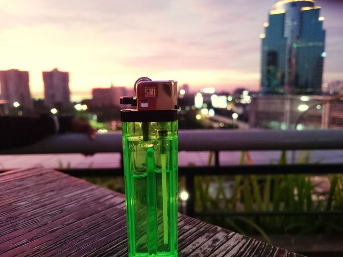 Sunset City Cityscape Urban Skyline Skyscraper Illuminated Water Sky Close-up Architecture Building Exterior Green Light Lookout Tower First Eyeem Photo