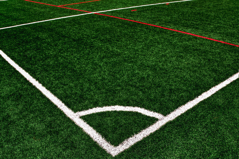 In the corner Competition Competitive Sport Corner Corner Kick Dividing Line Empty Grass Green Color Playing Field Soccer Soccer Field Soccer Team  Sport Stadium Team Sport Textured Effect Turf White Color