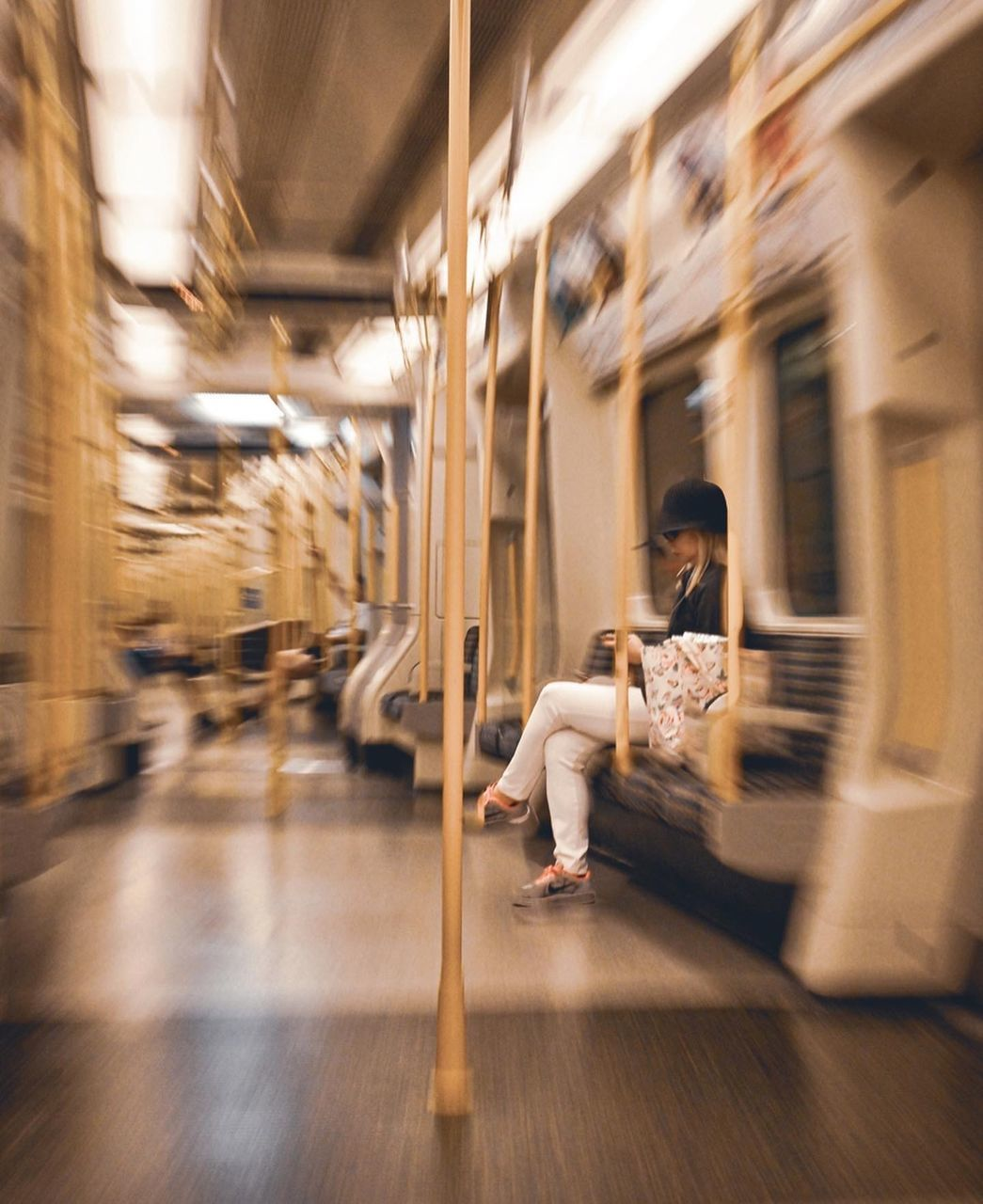 BLURRED MOTION OF PEOPLE SITTING AT SUBWAY TRAIN