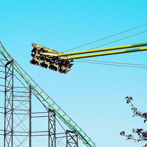 EyeEm Selects swinging high! Day Flying Low Angle View Sky Outdoors Amusement Park Ride Yellow And Green