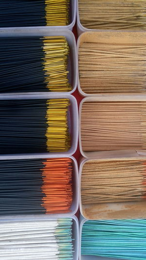 Full Frame Shot Of Incense Sticks In Containers