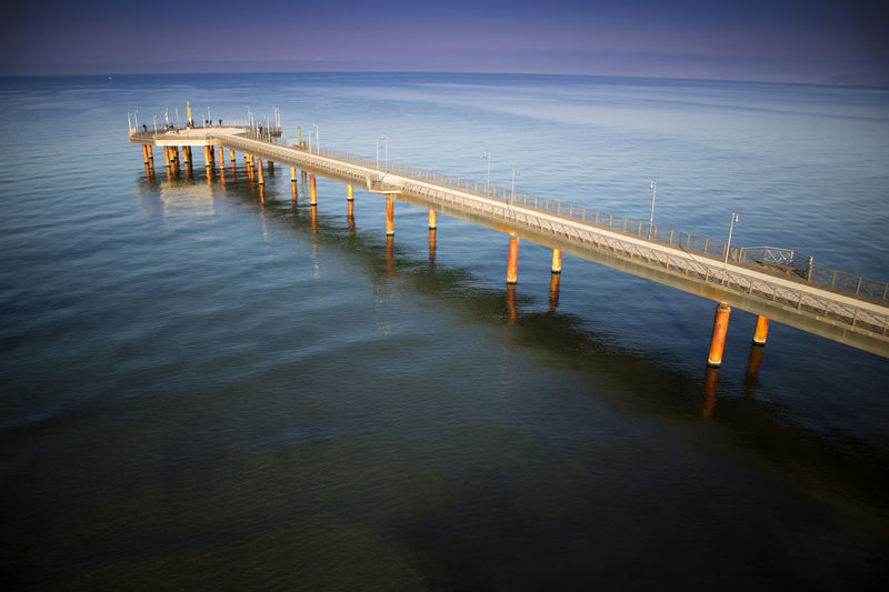 Water Sea Pier Nature Architecture No People Built Structure Sky Connection Tranquility Outdoors Bridge Bridge - Man Made Structure Twilight Wood - Material Dusk Railing Tranquil Scene Jetty
