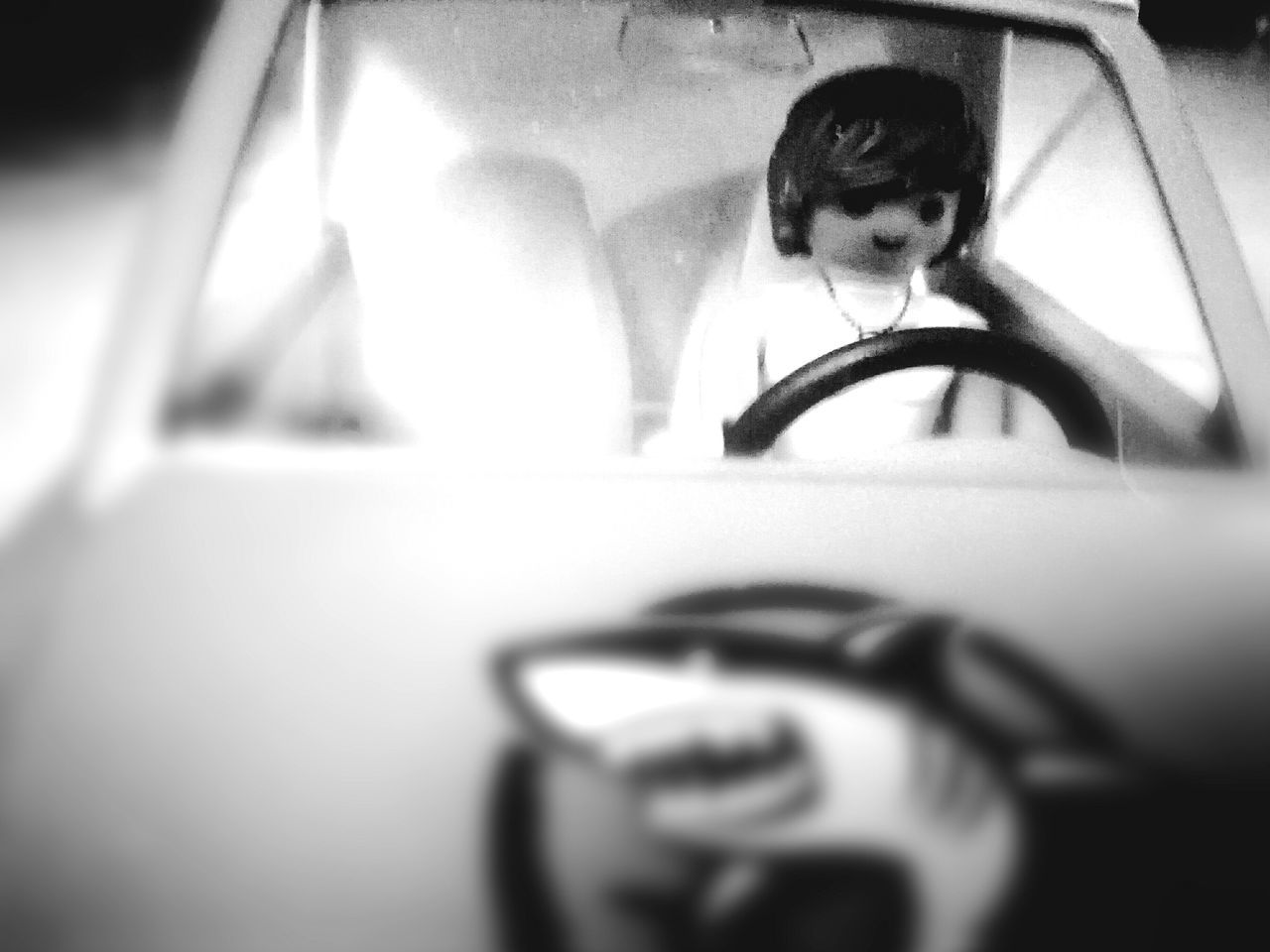 car, real people, car interior, childhood, transportation, mode of transport, land vehicle, one person, lifestyles, headshot, indoors, day, young women, young adult, close-up