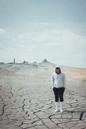 Full length of man standing on desert against sky