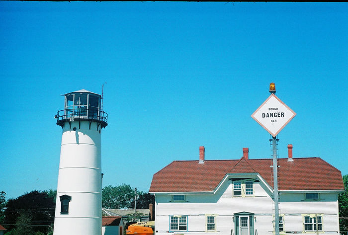 Lighthouse on Cape Cod, Massachusetts. Captured with a Leica ii on 35mm Fujifilm. Architecture Blue Blue Sky Built Structure Cape Cod Day Film Film Photography High Section Information Information Sign Lighthouse Low Angle View Massachusetts New England  No People Outdoors Road Sign Sky Summer Tall - High