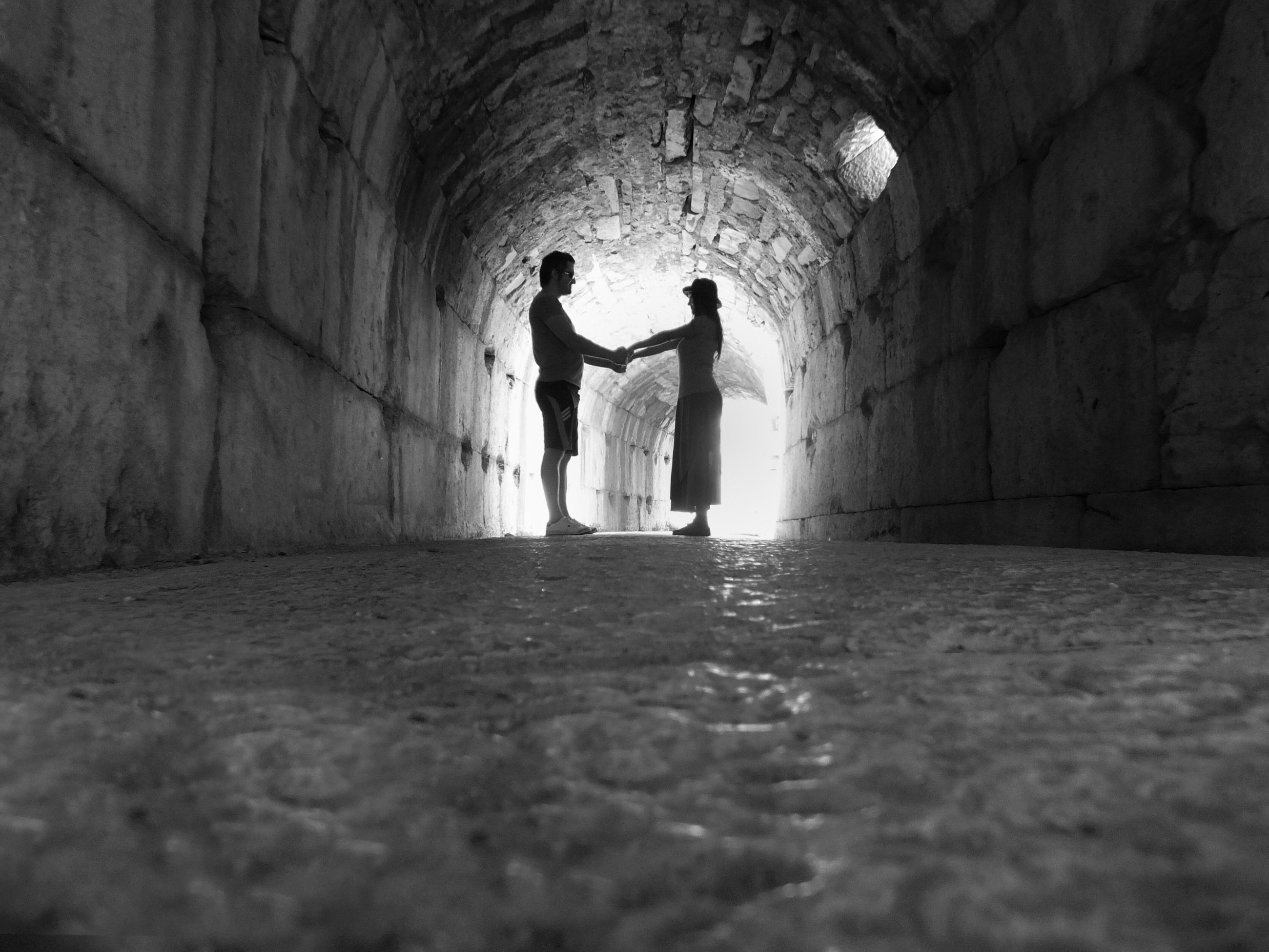 indoors, silhouette, men, full length, lifestyles, leisure activity, standing, wall - building feature, tunnel, rear view, walking, architecture, shadow, built structure, wall, outline, dark