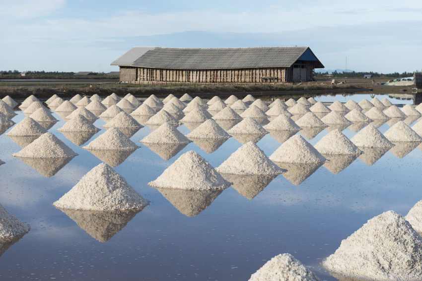 Salt farming in Thailand Architecture Blue Built Structure Cloud Cloud - Sky Day Farming Nature No People Outdoors Repetition Roof Roof Tile Salt Sky Sunny Tranquility Travel Destinations Water