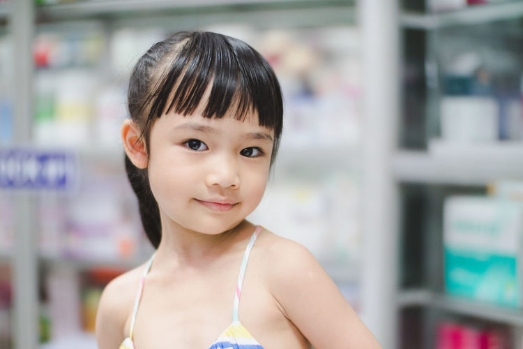 Portrait Childhood Child Headshot Looking At Camera One Person Smiling Focus On Foreground Girls Innocence Bangs Hairstyle Front View Females Store Retail  Hair Cute Indoors
