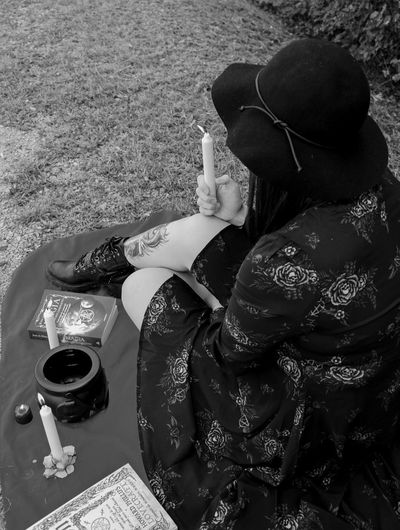 High angle view of woman holding drink