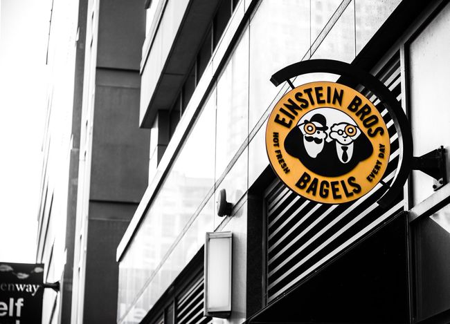 Chain Store. Einstein Bros. Bagels Shop Chicago Illinois USA Color Splash Blackandwhite Black And White Yellow Shops Shop Signs Text Logo Logo Design Photography Urban Photography Streetphotography Street Photography Eye4photography  No People Architecture Commercial Food Store