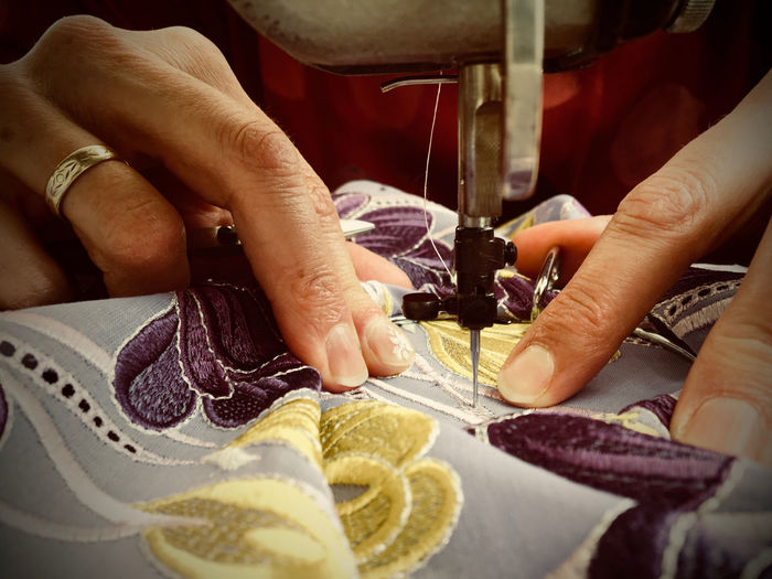 Close-up of hand sewing at home