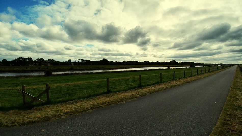 Cloudy Road Cloudy Road Sky Field Cloud - Sky Grass Tranquil Scene Weather Tranquility Cloud The Way Forward Scenics Empty Road Beauty In Nature Nature Rural Scene Day Green Color River View Agriculture Diminishing Perspective Greetsiel, Germany Greetsiel