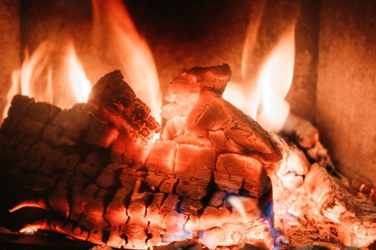 Fire in the fireplace Fire Flame Burning Fire - Natural Phenomenon Heat - Temperature No People Close-up Indoors  Orange Color Illuminated Glowing Wood Log Nature Firewood Wood - Material Night Fireplace Motion Chimney