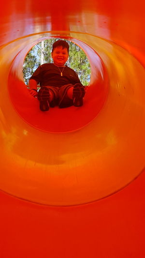 Red Orange Color Day Concentric Playtime Playing Outside Childhood Playground Tubeslide Tunnel View My Son Child Playing Children Photography